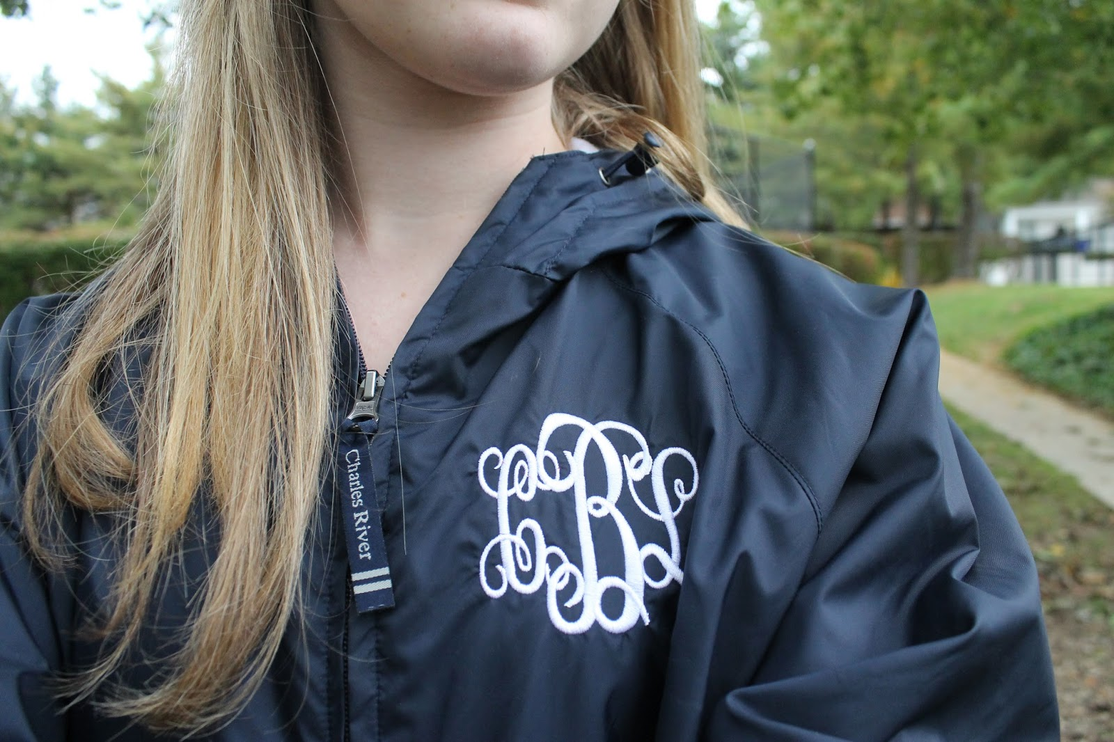 behind her monogrammed macbook  rainy octobers