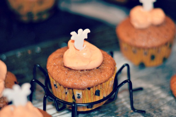 Pumpkin Spice Cupcakes in spider holders with ghost toppers