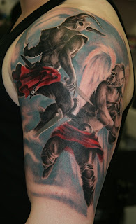 fighting angel and devil tattoo