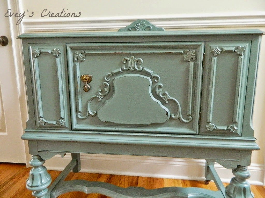 http://sweetsongbird.eveyscreations.com/2015/01/a-pretty-blue-girlvintage-buffet-redo.html