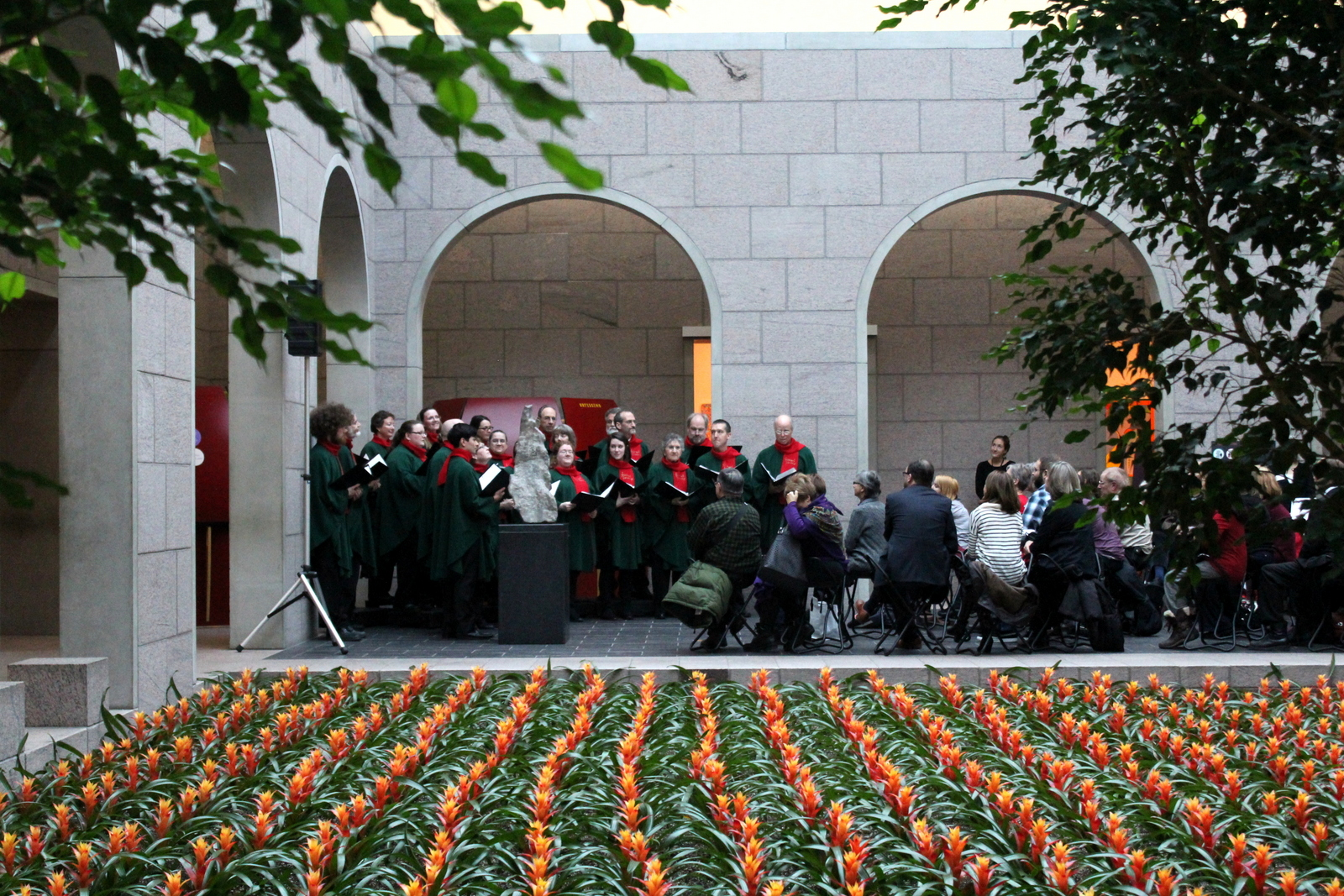 The Stairwell Carollers sing before a sea of bromeliads in the cloister at the National Gallery
