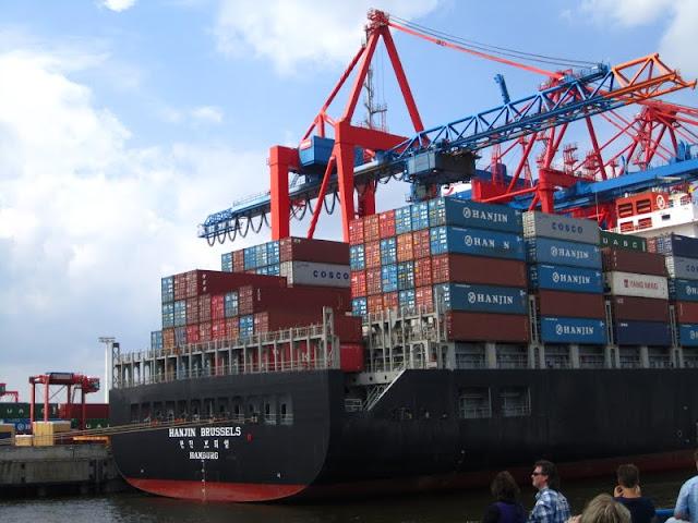 Freighter in Hamburg harbor front. Hamburg, Germany.