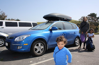 The car we ended up buying, with my family (my younger  daughter dressed to match).
