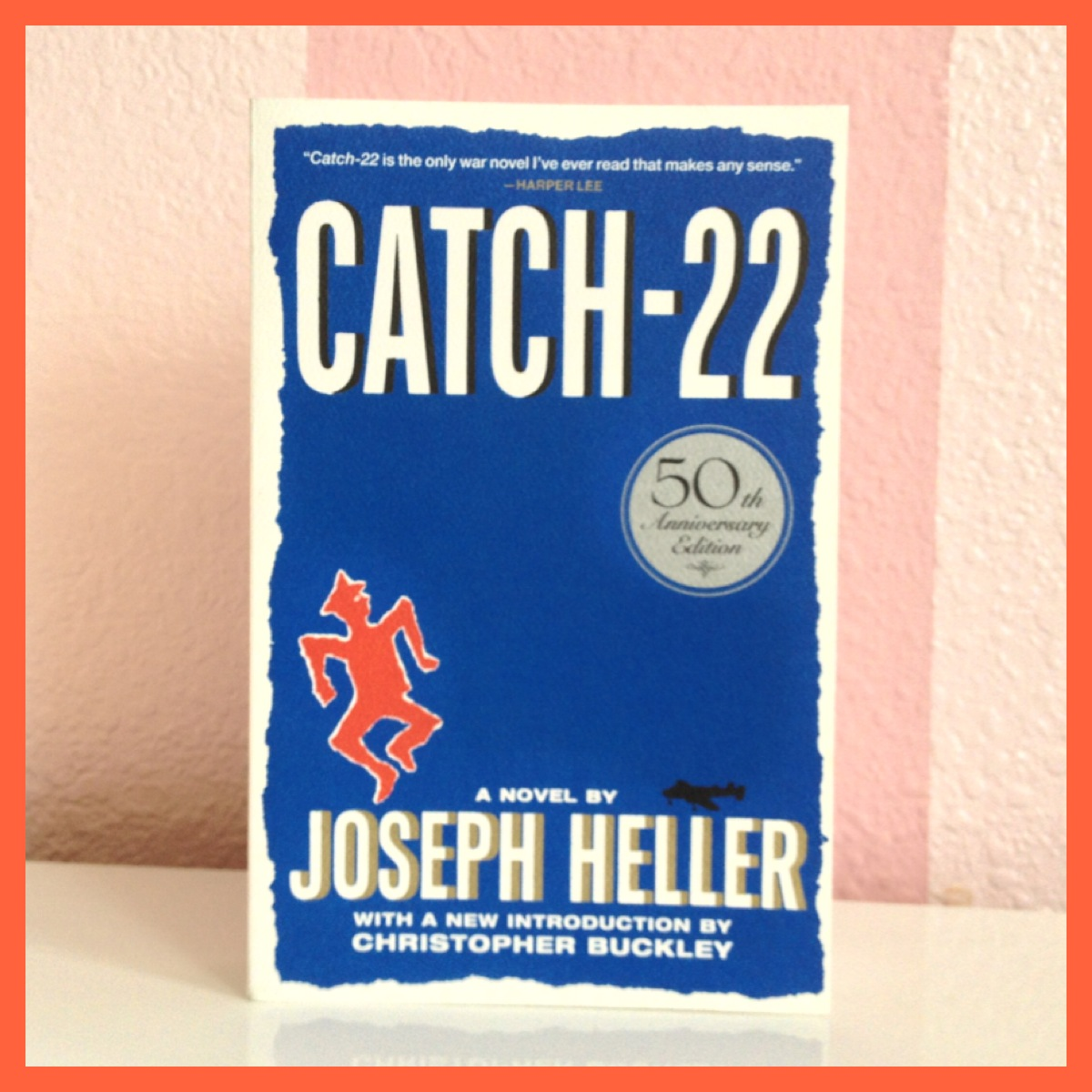 joseph hellers satire on the insanity of war in his novel catch 22
