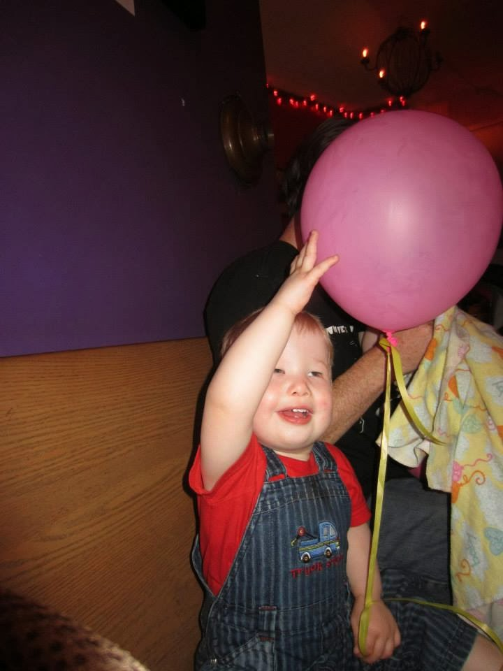 toddler with balloon