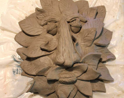 unfired sculpted clay tree face