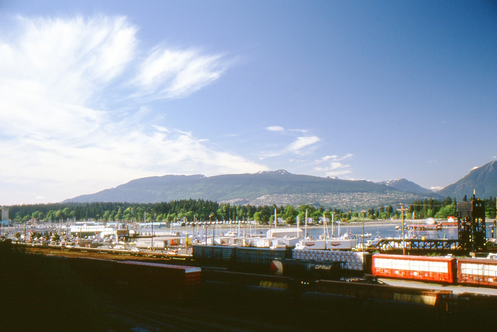 Northwest View Of Coal Harbour Burrard Inlet Vancouver BC Canada In Late May 1989 With Stanley Park And The North Shore Mountains Background
