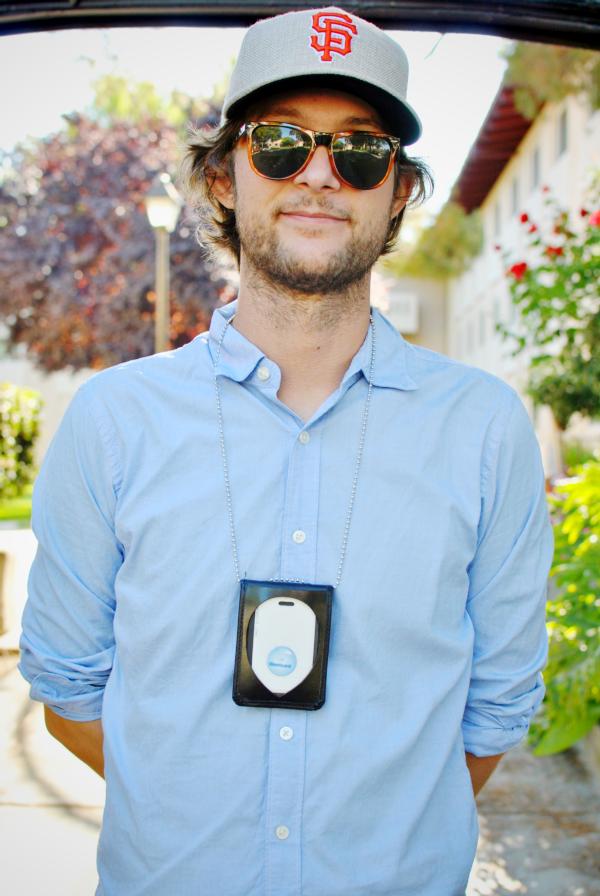 alan wearing his work badge like a boss