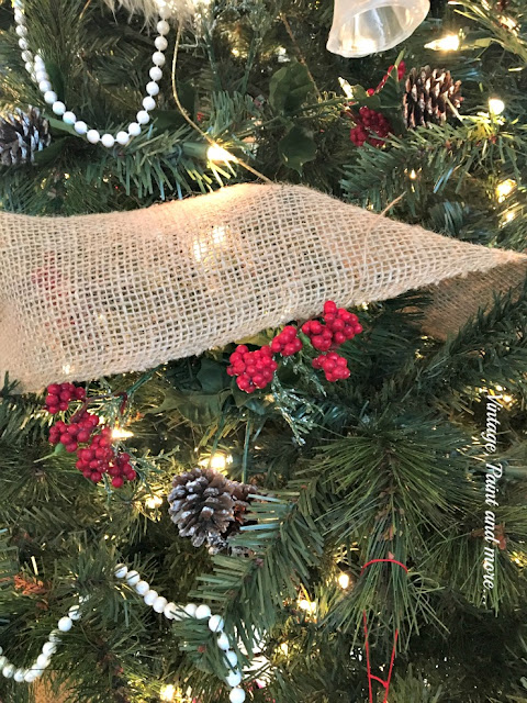 faux berries and pinecone pics from dollar store added to christmas tree