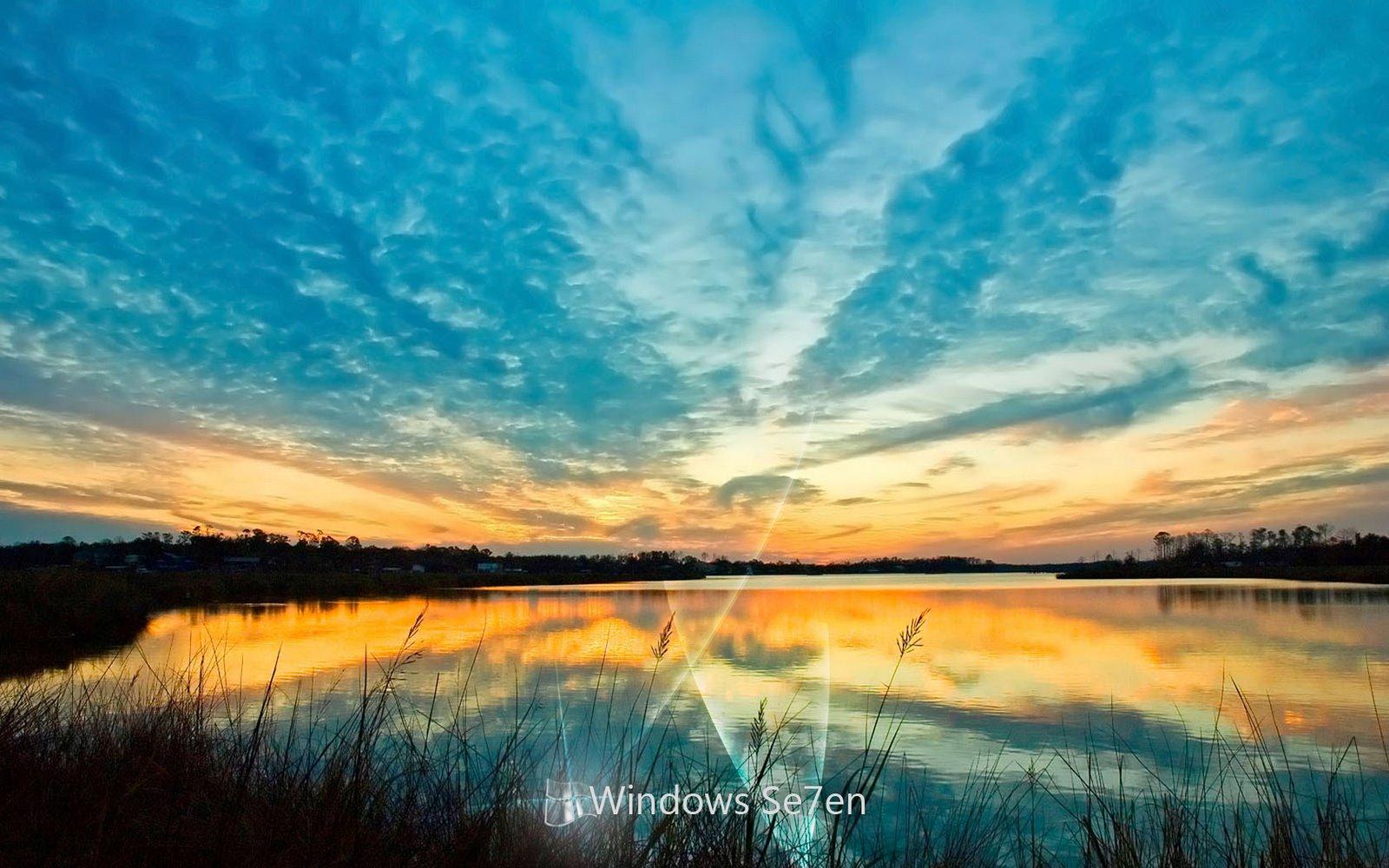 http://2.bp.blogspot.com/-mPqYpsHSuvI/TuUHPTj61kI/AAAAAAAABzg/MaMGy6k8_x8/s1600/windows_7_sunset_wallpaper.jpg