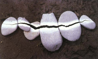 land art work of pebbles by andy goldsworthy