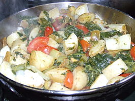 Cooking sea beet sag aloo