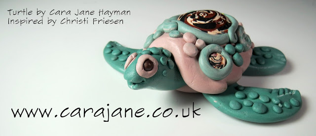 Small green and beige polymer clay turtle made by Cara Jane