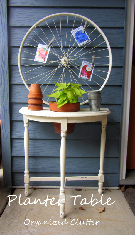 Upcycled & Repurposed Demi-lune Planter Table www.organizedclutterqueen.blogspot.com