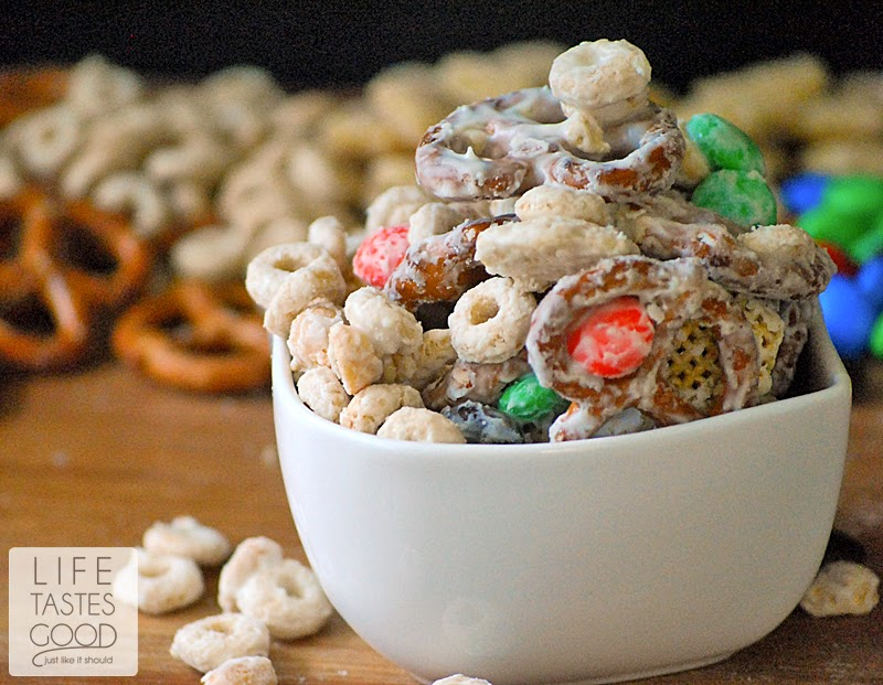 Easy Sweet and Salty Snack Mix | by Life Tastes Good is made with M&M's®, cereal, pretzels, and peanuts all covered in creamilicious white chocolate! #HeroesEatMMs #CollectiveBias #Shop