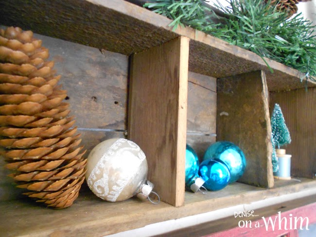 Pinecones and Ornaments in Vintage Wooden Cubbies via Denise on a Whim