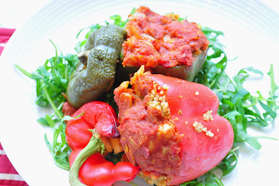 Couscous and Halloumi stuffed peppers with a tomato sauce