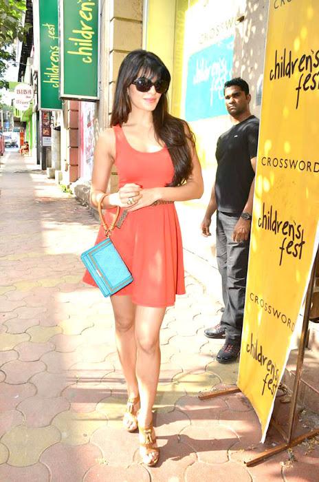 Jaqueline Fernandez Spicy Pictures in Orange Short Skirt with High heels