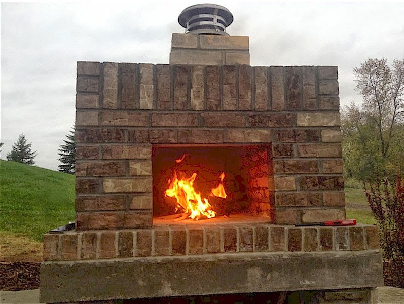 the olson family wood fired pizza oven is a perfect match for the all new paver patio this large backyard project a new brickwood oven and a
