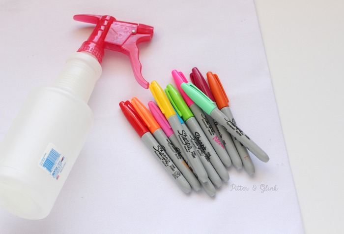 Use rubbing alcohol and Sharpies to create a watercolor effect on fabric. pitterandglink.com