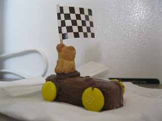 Cheryl built mini candy bars into race cars with Teddy Graham cracker drivers and M&M wheels