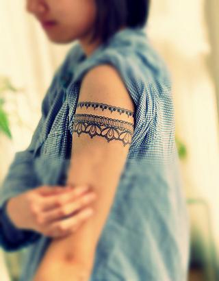 Lace on arm female tattoo female tattoos gallery for Feminine forearm tattoos