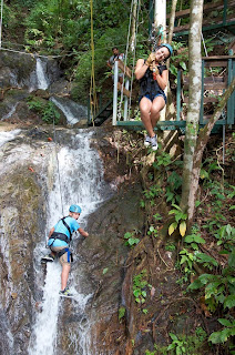 To reach the zip line on the top of the waterfall, you have to climb it yourself with just a safety harness!