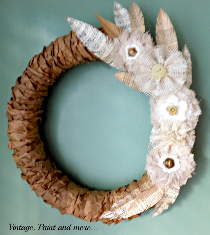 Rustic fall wreath made from paper lunch bags, book page feathers and burlap flowers at One MoreTime Events.com