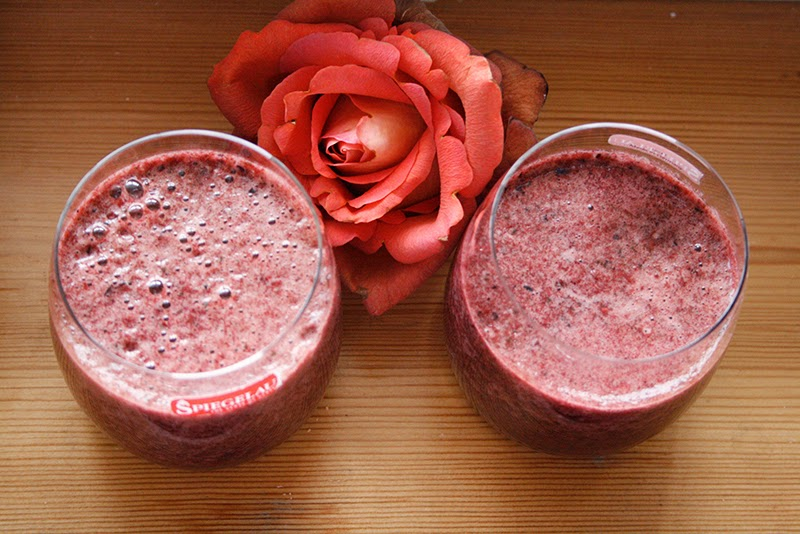 pink smoothie with spinach and berries and orange