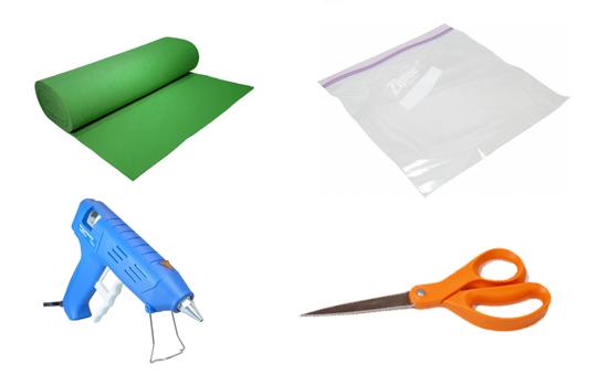 ادوات العمل: كيس بلاستيكي، قماش الجوخ، أو الورق الملون، غراء المسدس، مقص