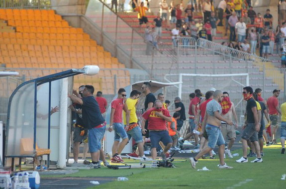 Furious fans invade the pitch in an attempt to attack Lecce players in the dressing room
