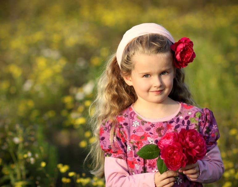 girl with little flower - Child Pictures Download