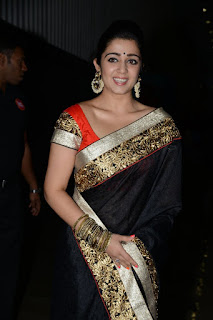 Charmee Kaur in Black saree at Jyothilakshmi audio release function