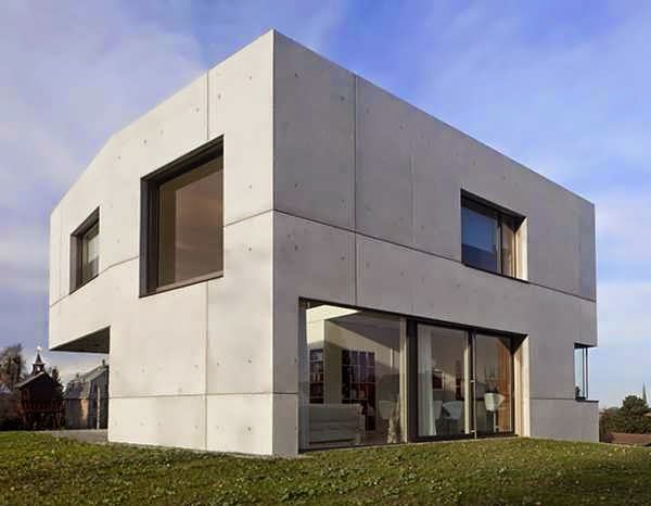 Contemporary cubic facade of concrete and glass house design stands in sharp contrast to the - The cubic home ...
