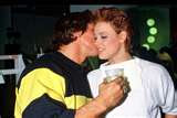 Schwarzenegger with his arm around Brigitte Neilsen