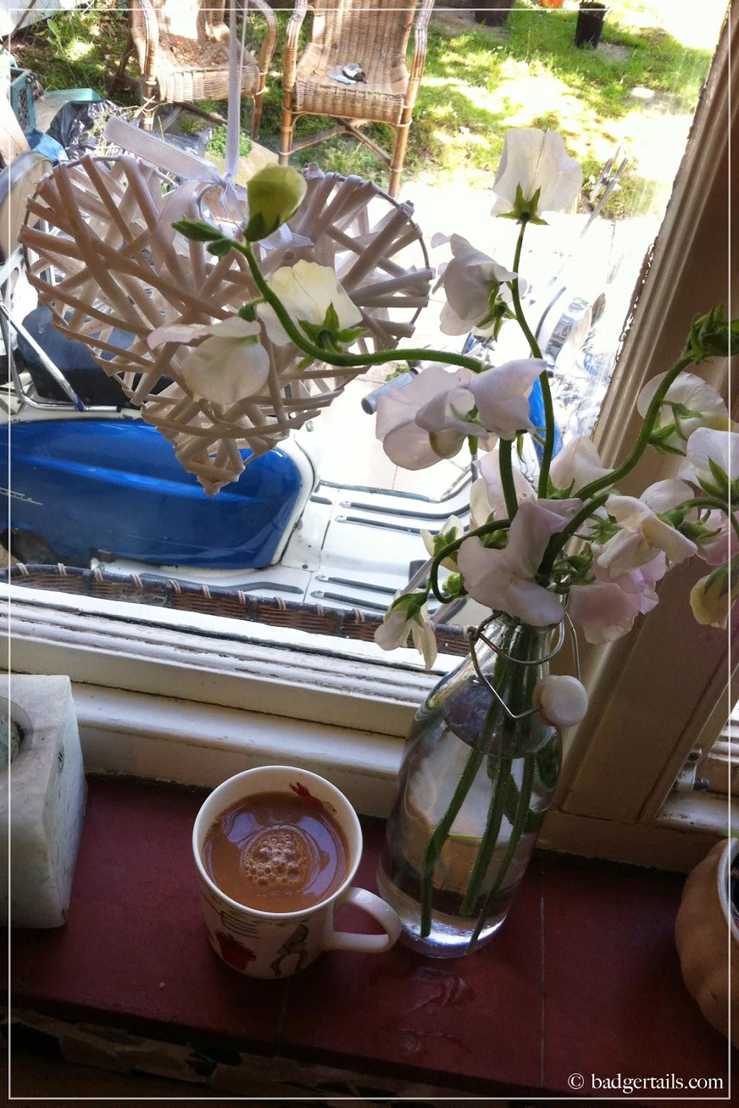 sweet peas and english tea on window sill in summer