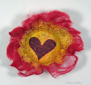 Yellow thread  bowl with red heart and red yarn roving base