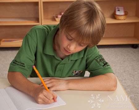 NAMC simplicity in montessori environment boy writing
