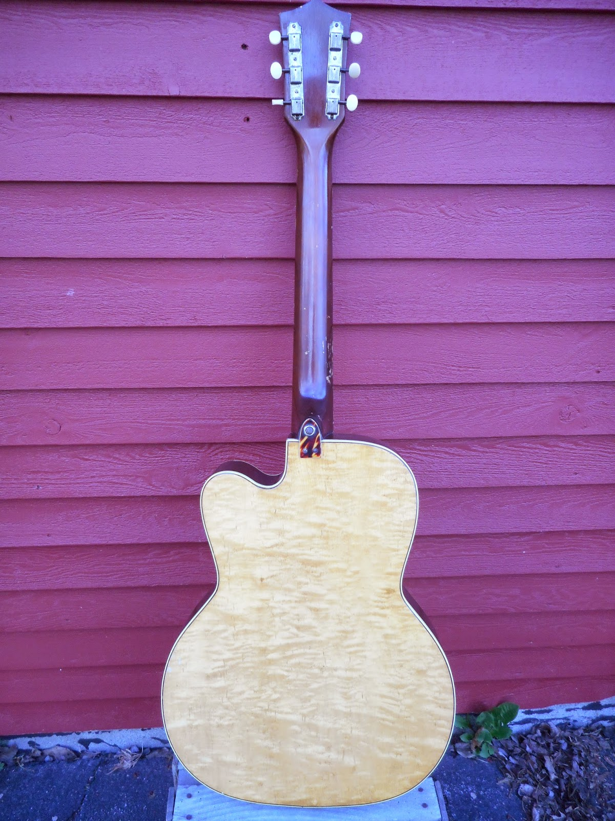Another wonderful guitar mystery brought to you by the Kay Guitar  Manufacturing Company.