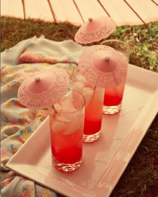 Pretty and romantic lace drink umbrellas.