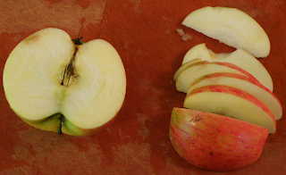 Cut-up Apple on Cutting Board