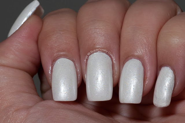 The Nail Junkie - Snowflake over Milani - White On The Spot