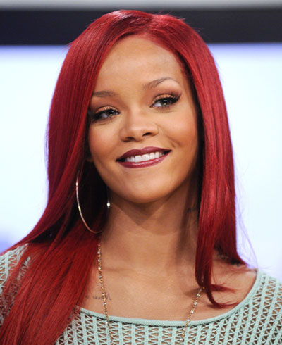 rihanna hairstyles 2010 red hair. 2010 rihanna red hair curly.