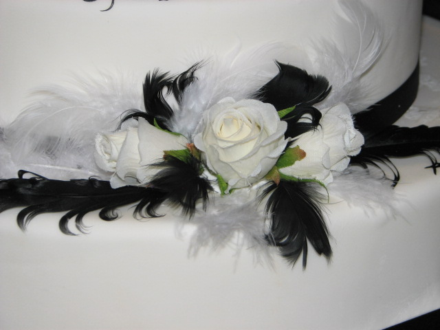 Feathers and rosesmock wedding cake For a real cake I would make sugar