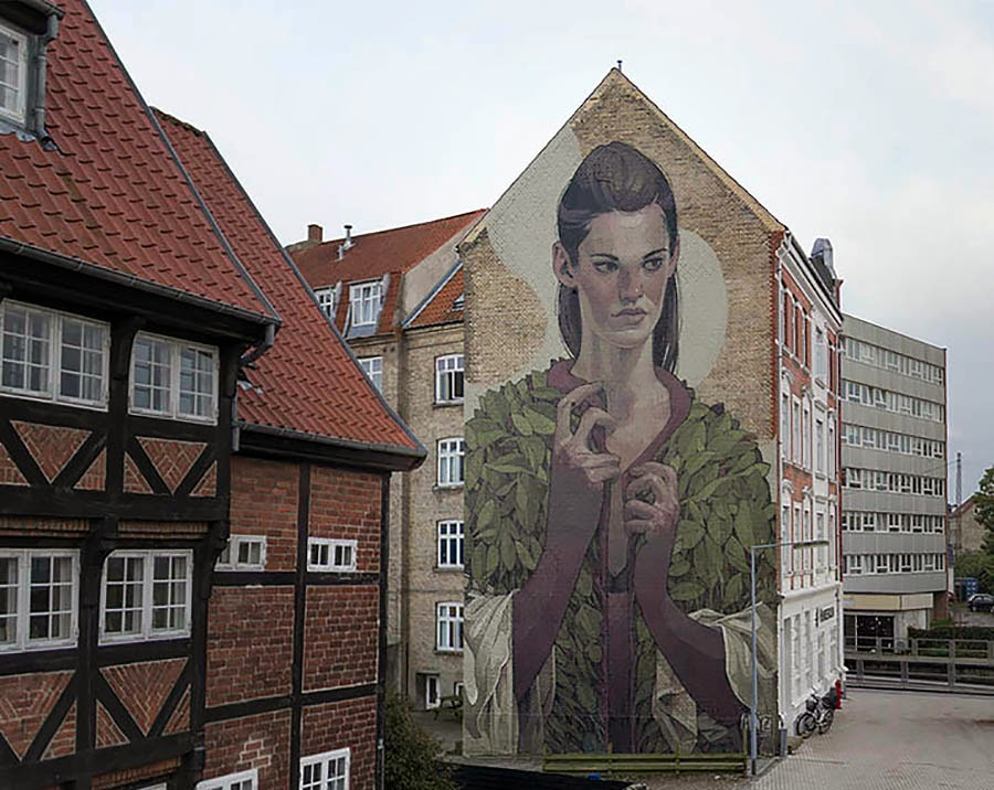 The We Aart Festival is underway and Aryz has finished the first mural on the streets of Aalborg, Denmark.