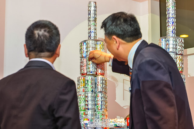 Final touch by Mr Vincent Wong Wai Sang, Political Secretary, Minister in Prime Minister's Department to complete the sculpture of Petronas Twin Towers which made of aluminium pop tabs