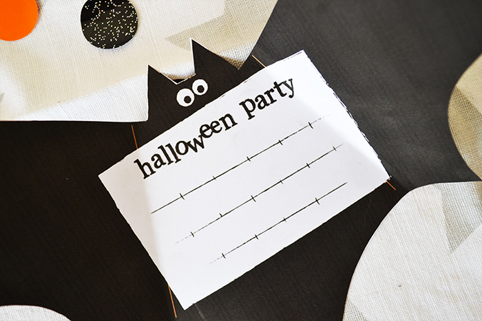 Bat shaped Halloween party invitation card