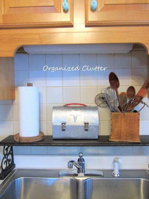 An Industrial Look Kitchen with Tin and Aluminum Utensils www.organizedclutterqueen.blogspot.com