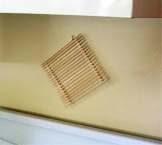alas panci panas sebagai hiasan dinding