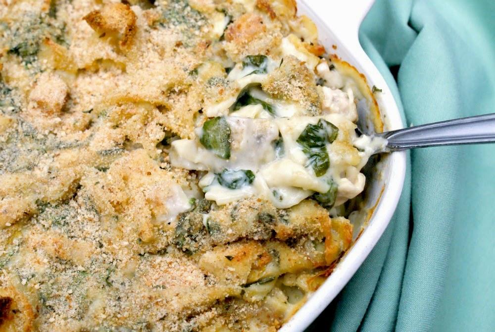 A creamy cheesy chicken casserole with spinach and artichokes.